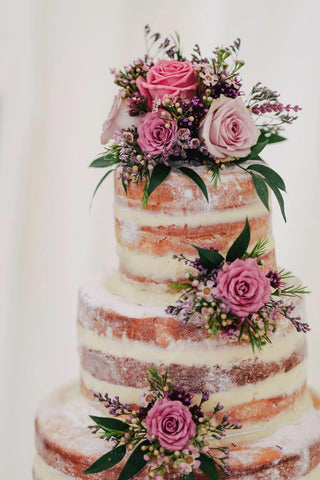 wedding cake with flowers on it