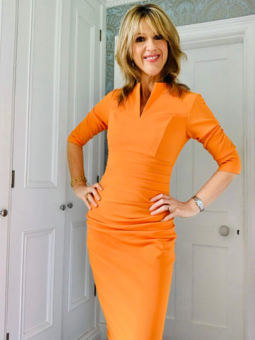 Jules Standish in orange divacatwalk pencil dress