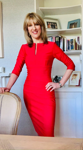 Jules wears a red Diva Catwalk pencil dress