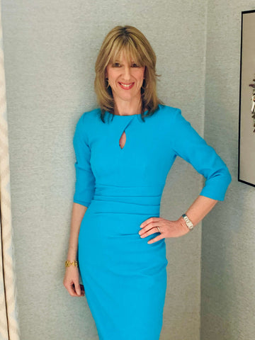 Jules Standish wears a blue Diva Catwalk pencil dress