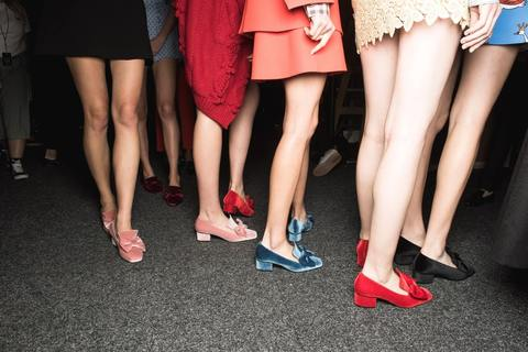 a group of women in kitten heels