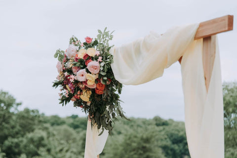 photograph of decoration and flowers for an outside wedding