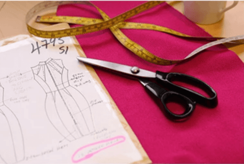 Picture of a Diva pattern measuring tape fabric scissors in the Diva design room.