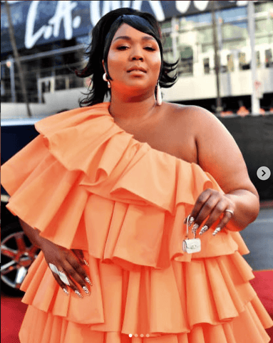 Lizzo wearing Valentin-HO custom look for American Music Awards