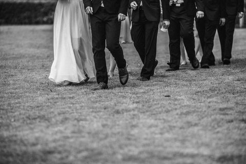 bride, groom, bridesmaids, groomsmen, walking, black and white