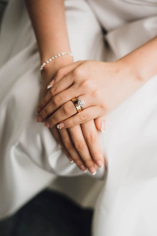 bride with hands with rings