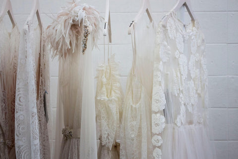 white dresses hanging wedding