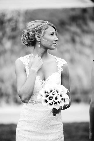 bride in queen anne neckline dress black and white photo