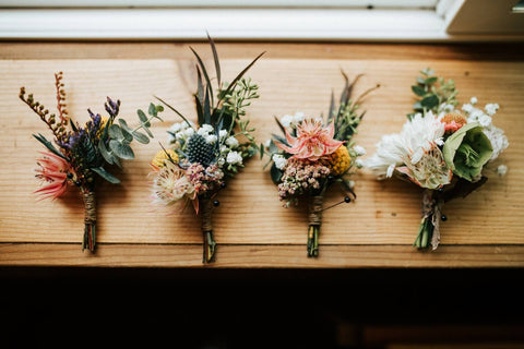 bunches of flowers on a wooden table