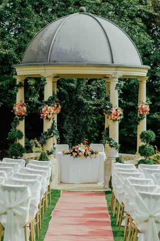 wedding set up for the ceremony with chairs walkway and altar