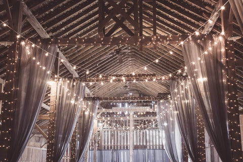lights hanging up as wedding decoration