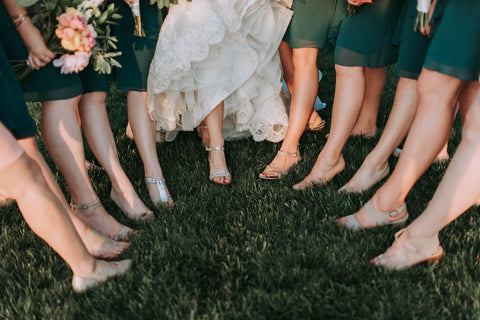bride and bridesmaids standing in a semi circle pointing their toes