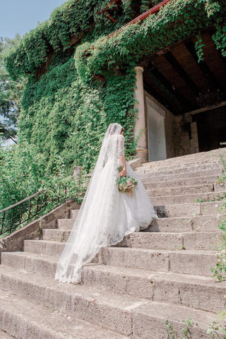 bride walking up steps in her dress