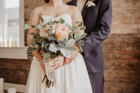 bride and groom with yellow flowers