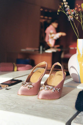 blush pink sandals on a table