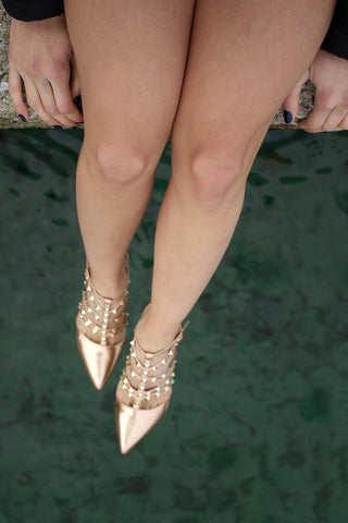 legs on woman in gold heels