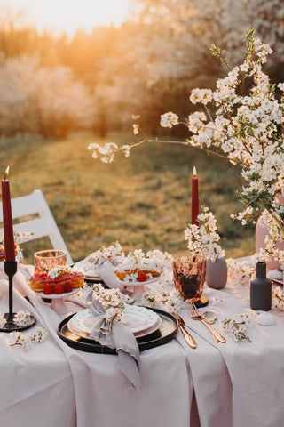 wedding table laid with flower in goldern hour