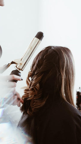 woman having her hair curled