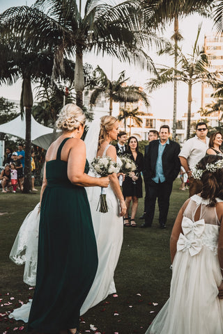mother walking her daughter down the aisle