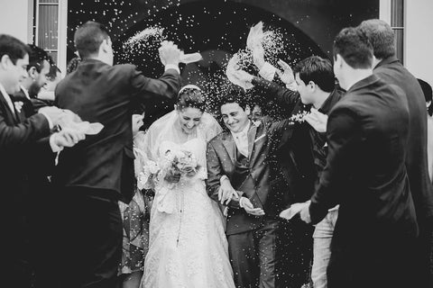 bride and groom, confetti, groomsmen black and white photograph