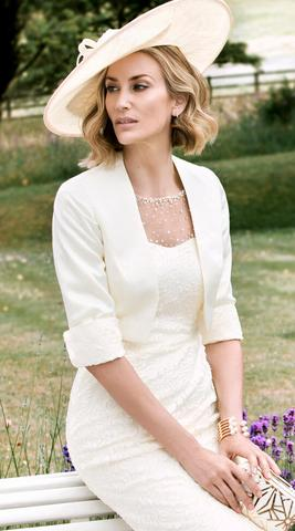 woman dressed in white wearing a hat