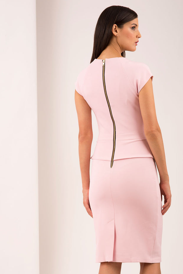 A brunette Model is wearing a pencil dress with round neckline with split detail by Diva Catwalk in baby pink