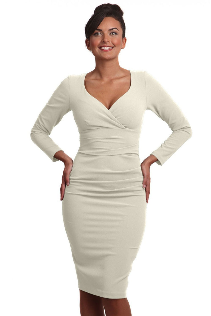 Model wearing the Diva Cynthia Pencil dress with pleating across the front in ivory cream front image