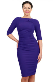 Model wearing the Diva Carlotta Pencil dress with pleat detail at the neckline and across the front in indigo blue front image