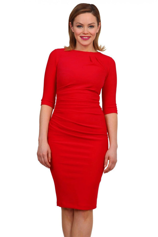 Model wearing the Diva Carlotta Pencil dress with pleat detail at the neckline and across the front in true red front image