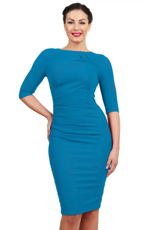 Model wearing the Diva Carlotta Pencil dress with pleat detail at the neckline and across the front in mosaic blue front image