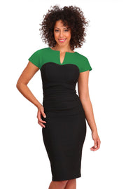 Model wearing the Diva Bryony Contrast dress with contrasting top and exposed zip at the back in black and emerald green front image