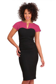 Model wearing the Diva Bryony Contrast dress with contrasting top and exposed zip at the back in black and rose pink front image