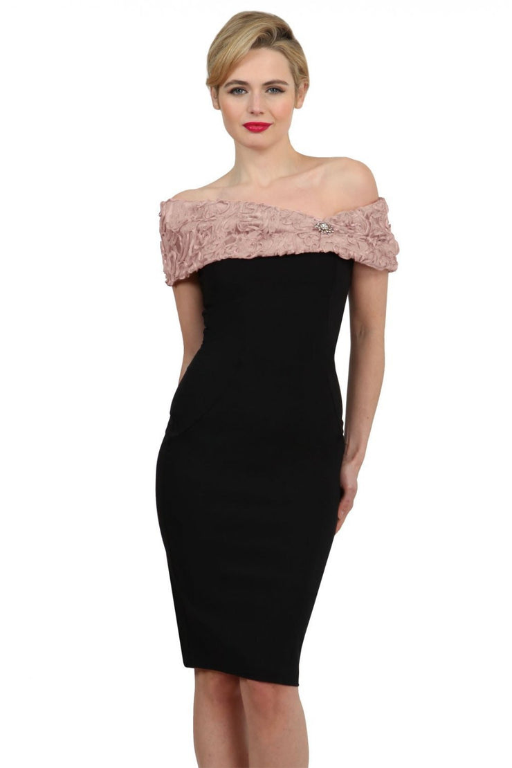 Model wearing the Diva Cornelli Perth dress with cornelli lace top, off shoulder design and diamanté brooch in black and nude front image