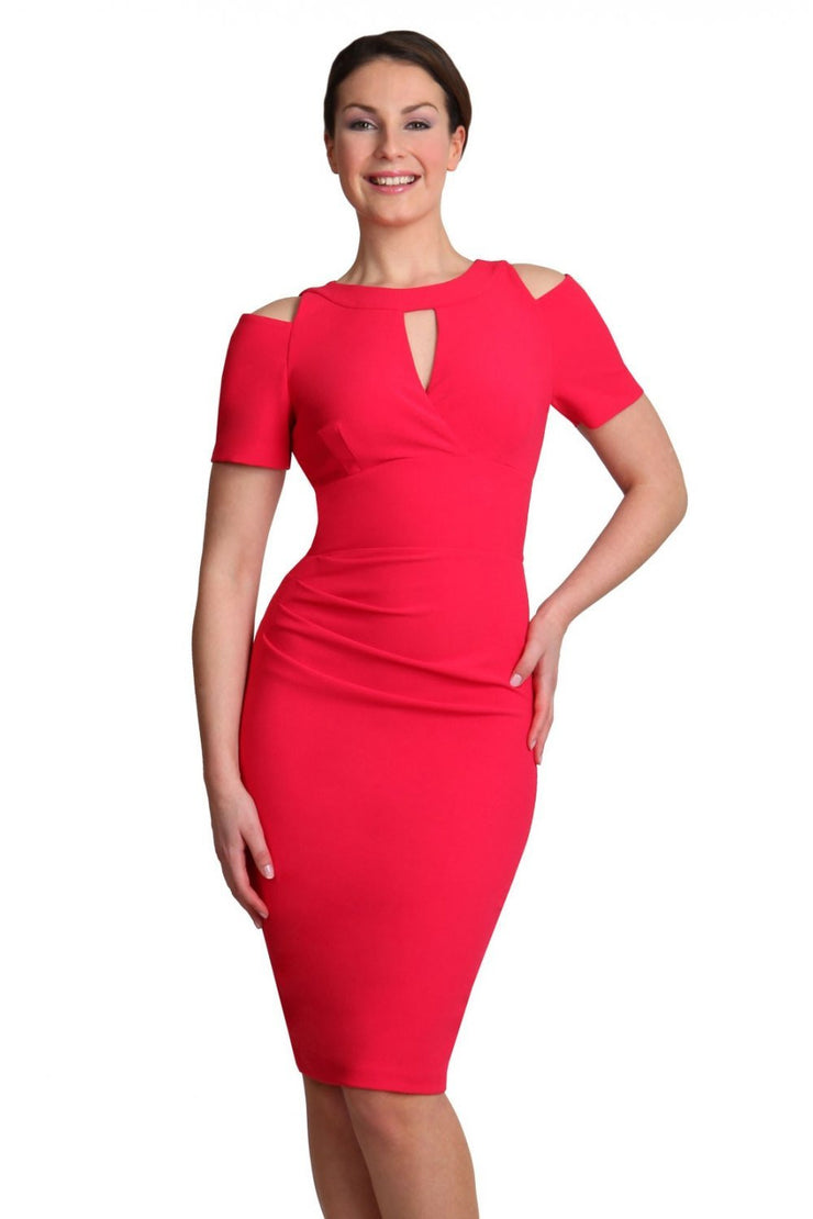 model wearing diva catwalk ruth pencil skirt dress with a keyhole cut in rounded neckline and cold shoulder detail in honeysuckle pink colour front
