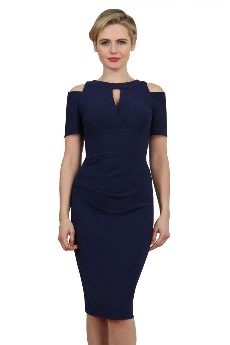 model wearing diva catwalk ruth pencil skirt dress with a keyhole cut in rounded neckline and cold shoulder detail in navy blue colour front