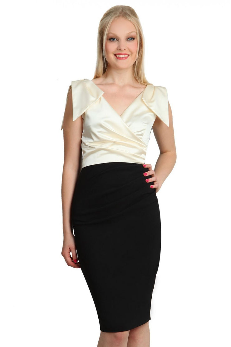 Model wearing the Diva Broadway Satin dress with satin bodice to front and pleating at the front in black and gardenia cream front image