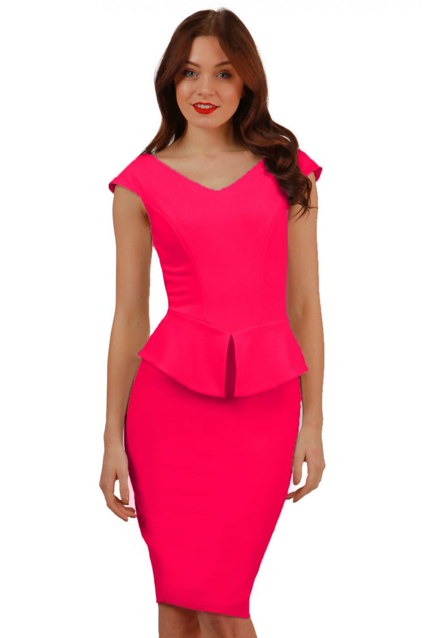 Model wearing the Diva Azalea Peplum dress with semi V neckline and peplum waist detail in honeysuckle pink front image