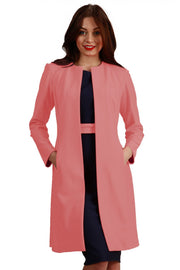 model wearing diva catwalk peach coat with long sleeves and a belt front