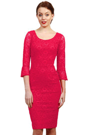 Model wearing the Diva Beatrice lace dress with round neck and pleated cuff in coral lace front image