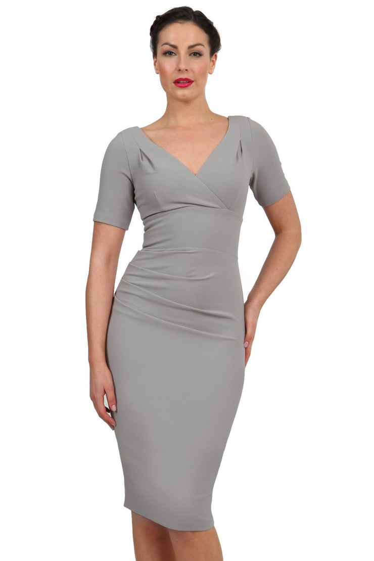 Model wearing the Diva Opal dress in pencil dress design in dove grey front image