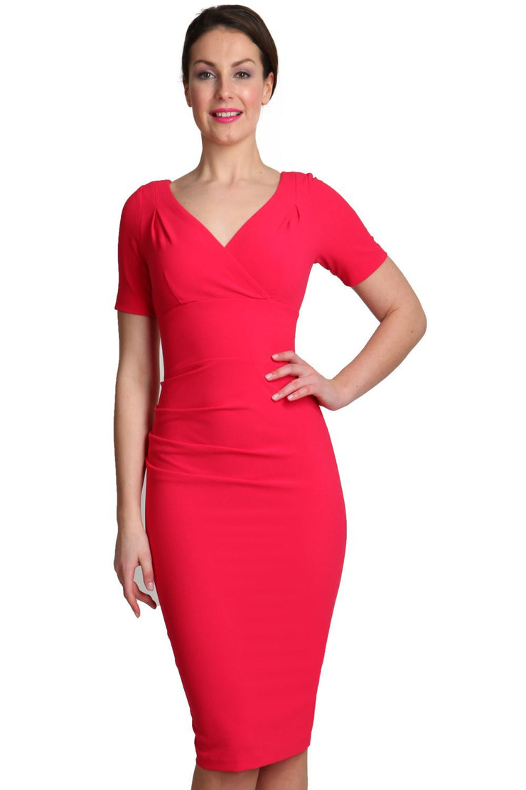 Model wearing the Diva Opal dress in pencil dress design in honeysuckle pink front image
