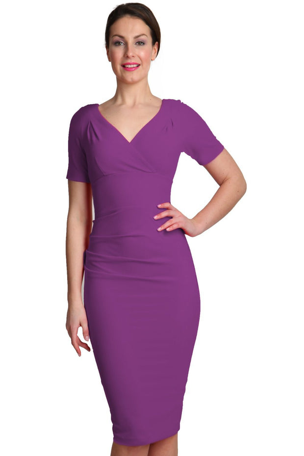 Model wearing the Diva Opal dress in pencil dress design in orchid purple front image