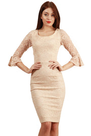 Model wearing the Diva Beatrice lace dress with round neck and pleated cuff in nude lace front image