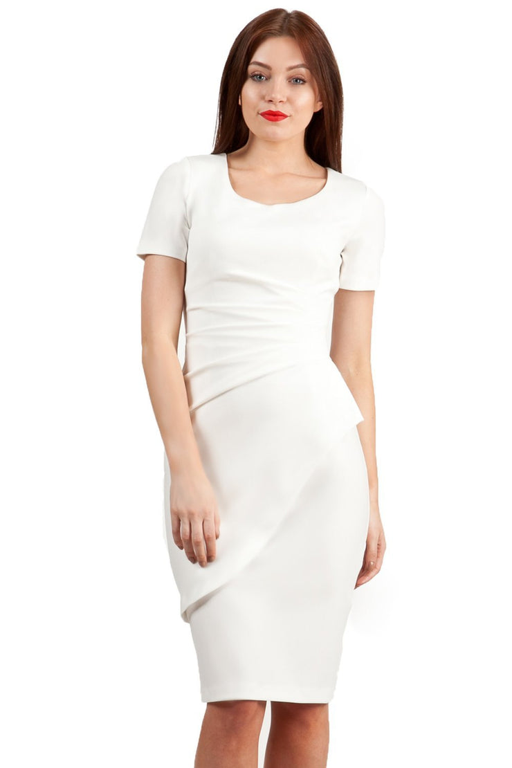 model wearing Diva Catwalk Katia short sleeve dress with an overlapped skirt and pleating across the tummy in ivory cream front