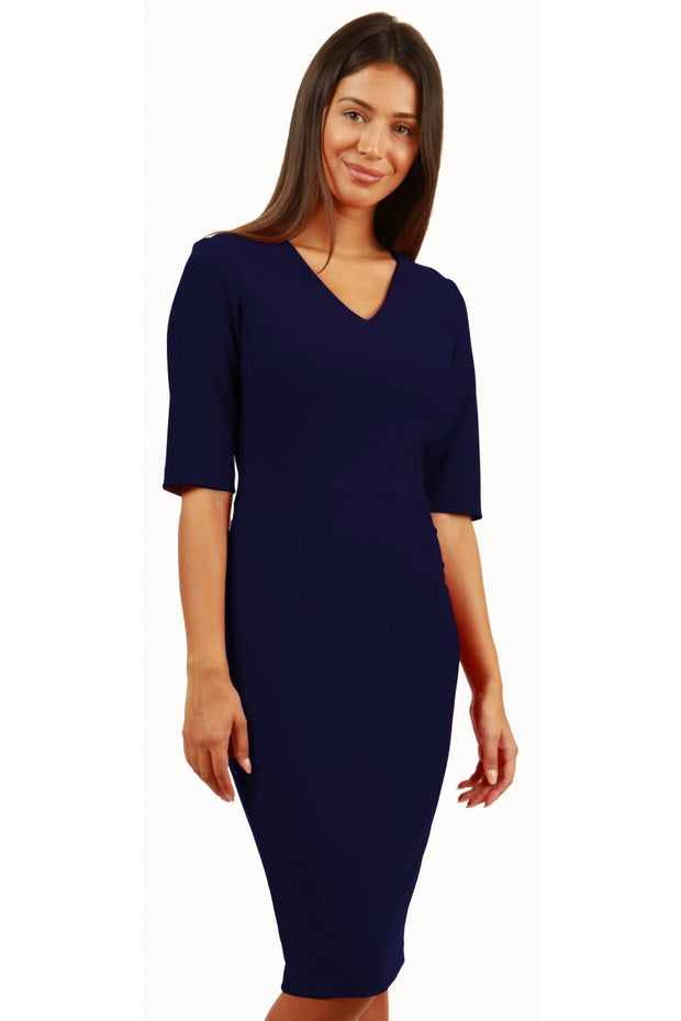 Model wearing the Diva Jessa dress in pencil dress design in navy blue front image