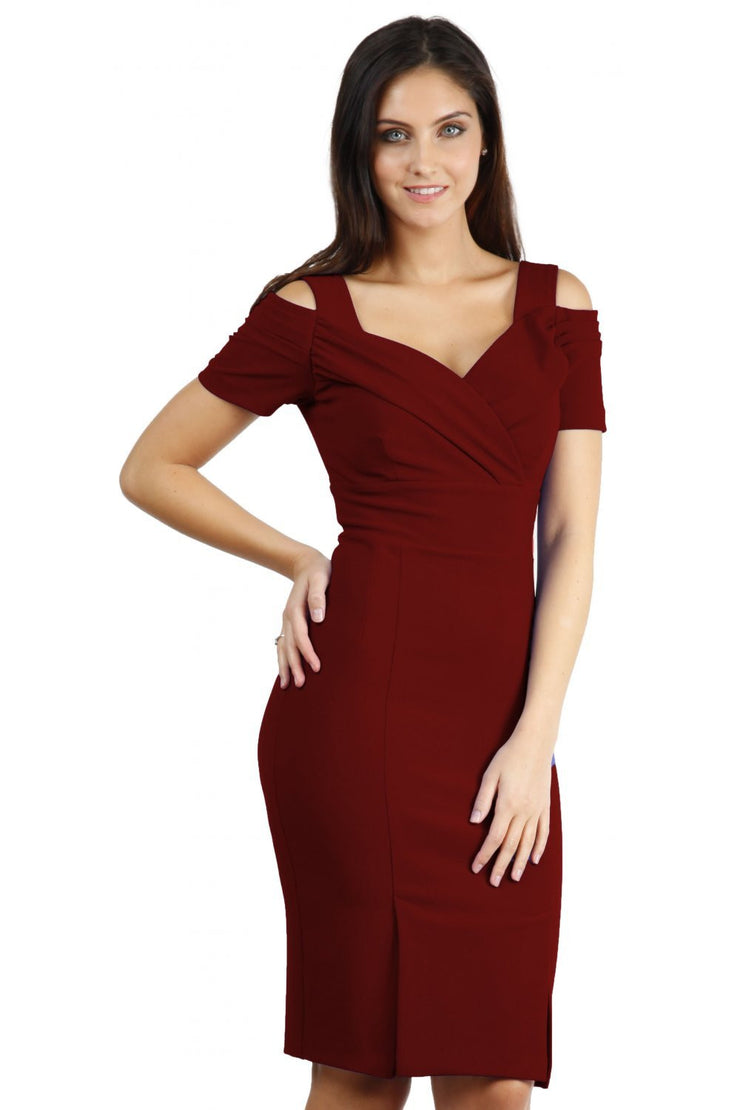 brunette model wearing diva catwalk amorette pencil skirt dress with a cold shoulder detaul and pleating across the bust and slit on a side of skirt in rosewood red colour front