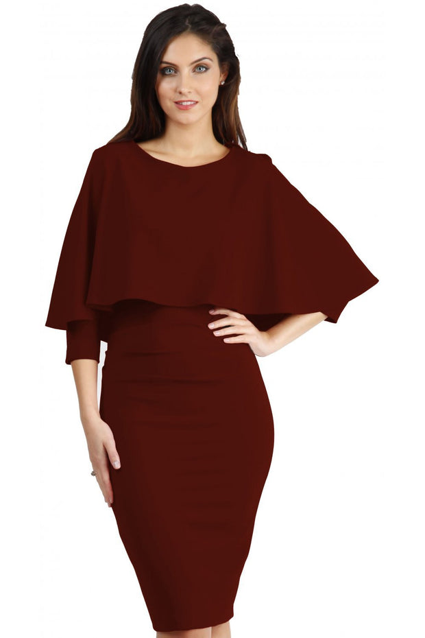 model wearing diva catwalk lizanne pencil-skirt dress with an attached wide cape detail and 3 4 sleeves in colour rosewood red front