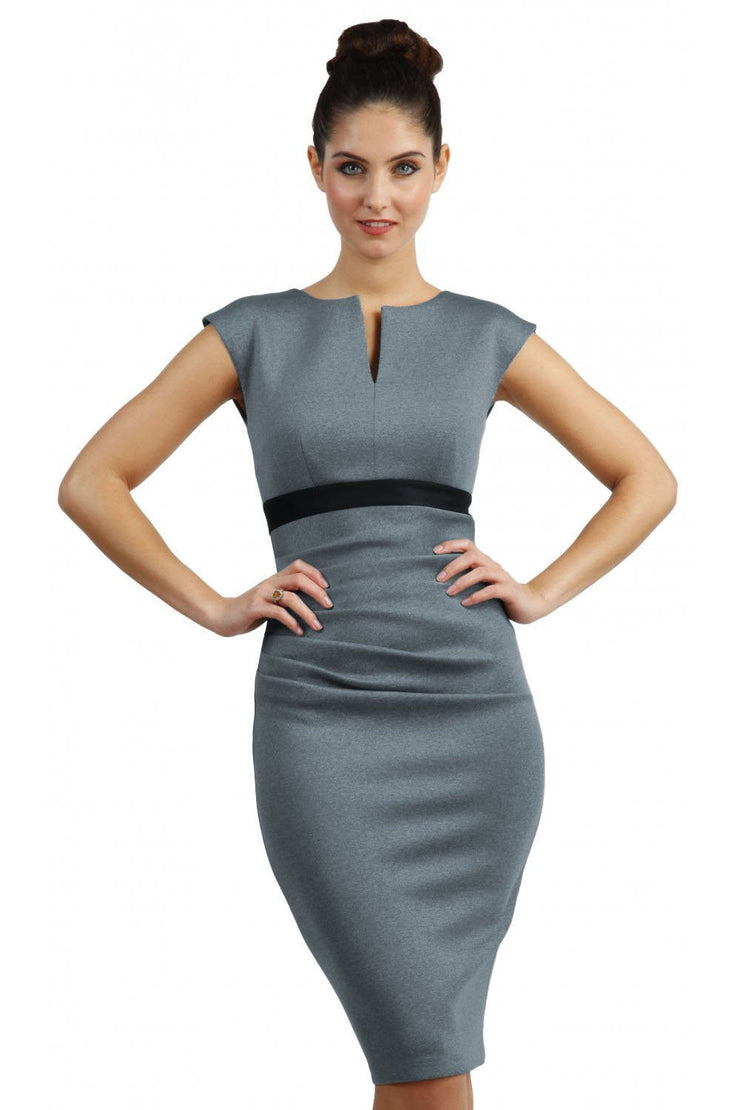 blonde model is wearing dive catwalk nadia sleeveless contrast band pencil-skirt dress with rounded neckline with a slit in the middle in blue front