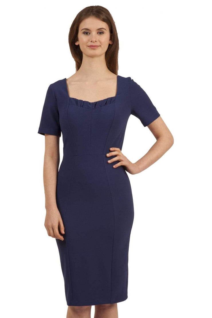 model wearing diva catwalk mitzi short sleeve pencil dress with square frilled neckline in navy blue front