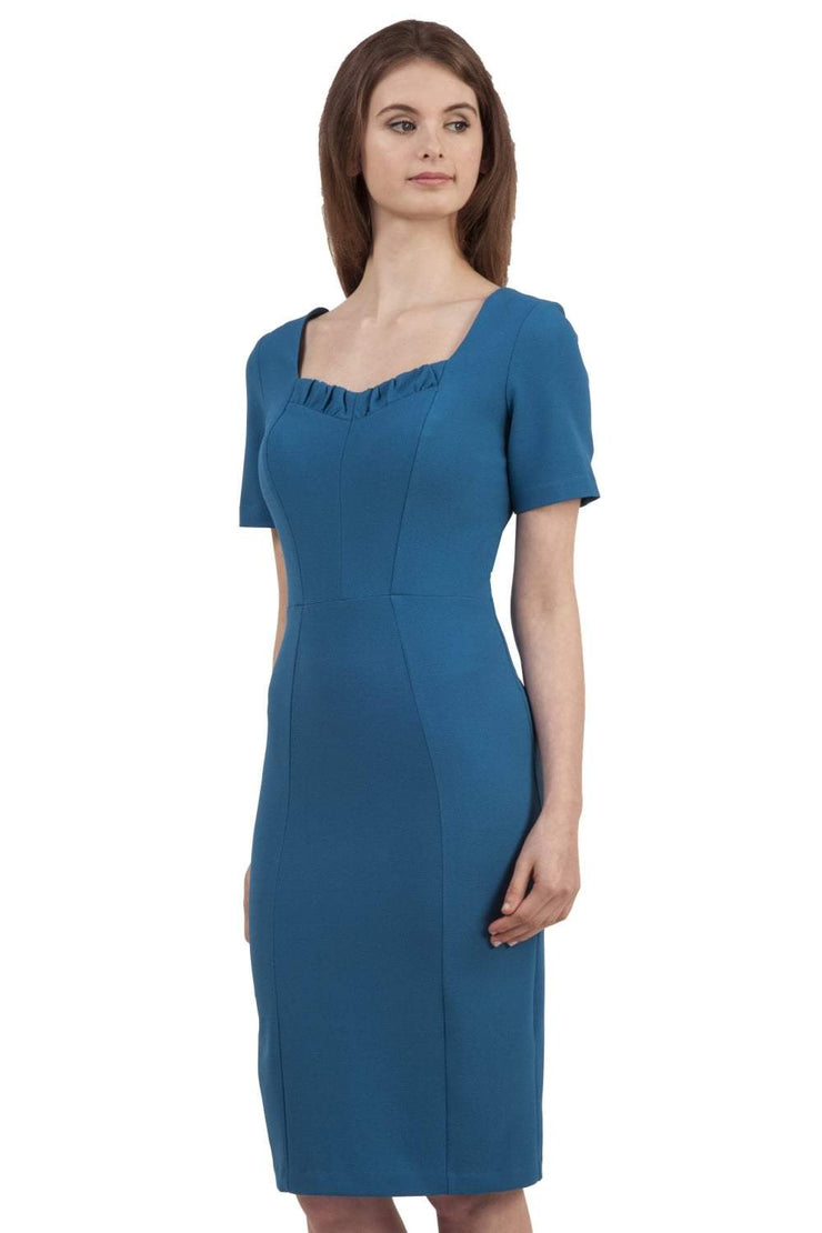 model wearing diva catwalk mitzi short sleeve pencil dress with square frilled neckline in tropic teal  front